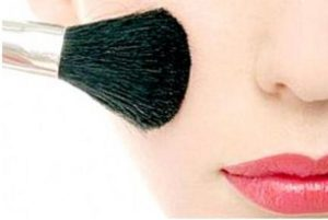 Make the shape of the face with blush