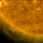 A Round UFO taking Energy from the Sun, Surprised in the Images